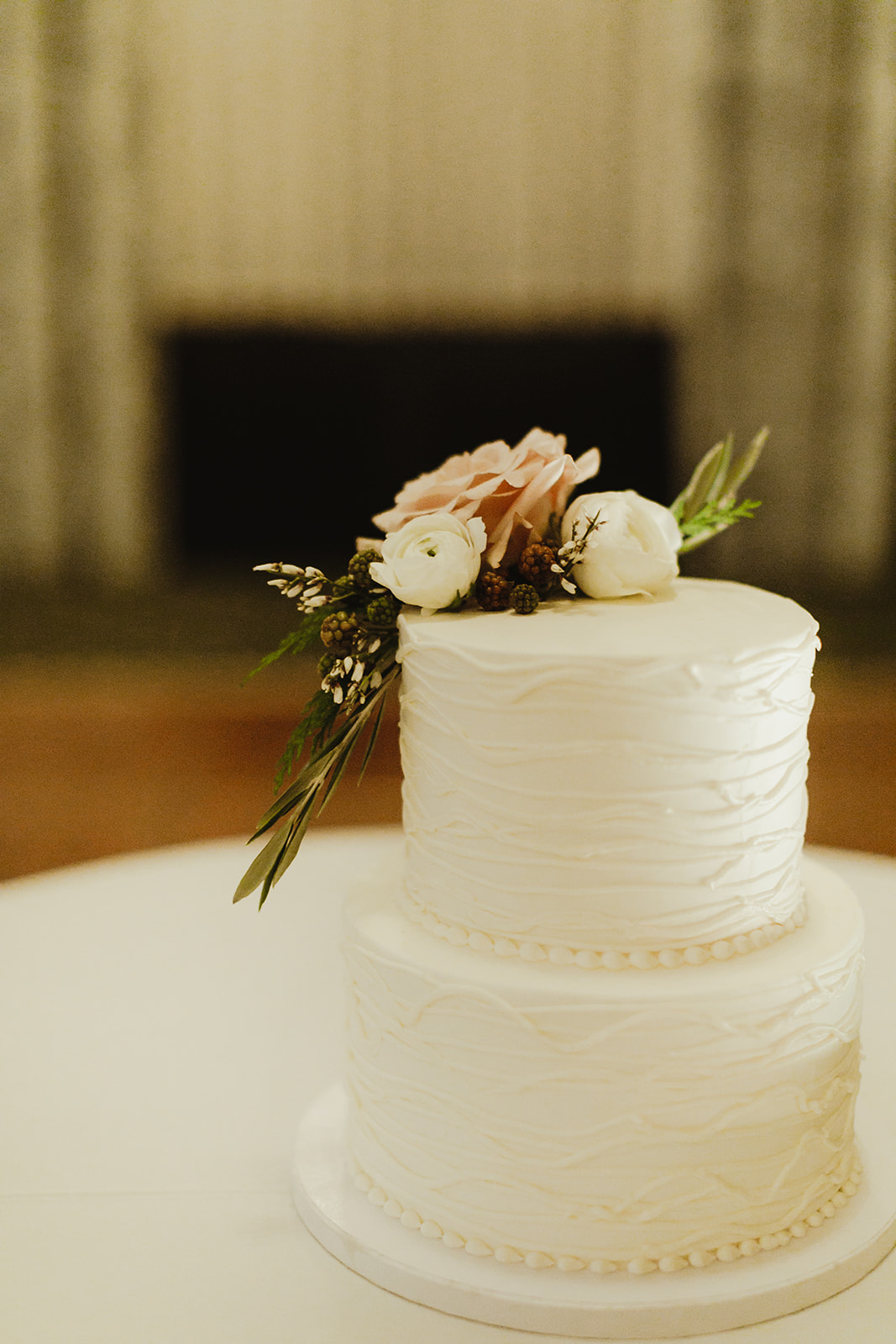 A white wedding cake with flowers on it