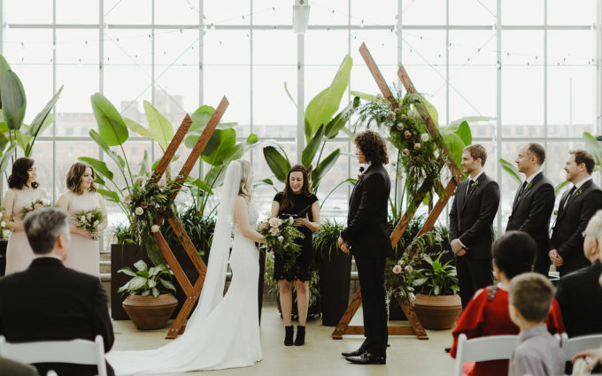 Bride and groom enjoying their ceremony during their Downtown Market Grand Rapids wedding