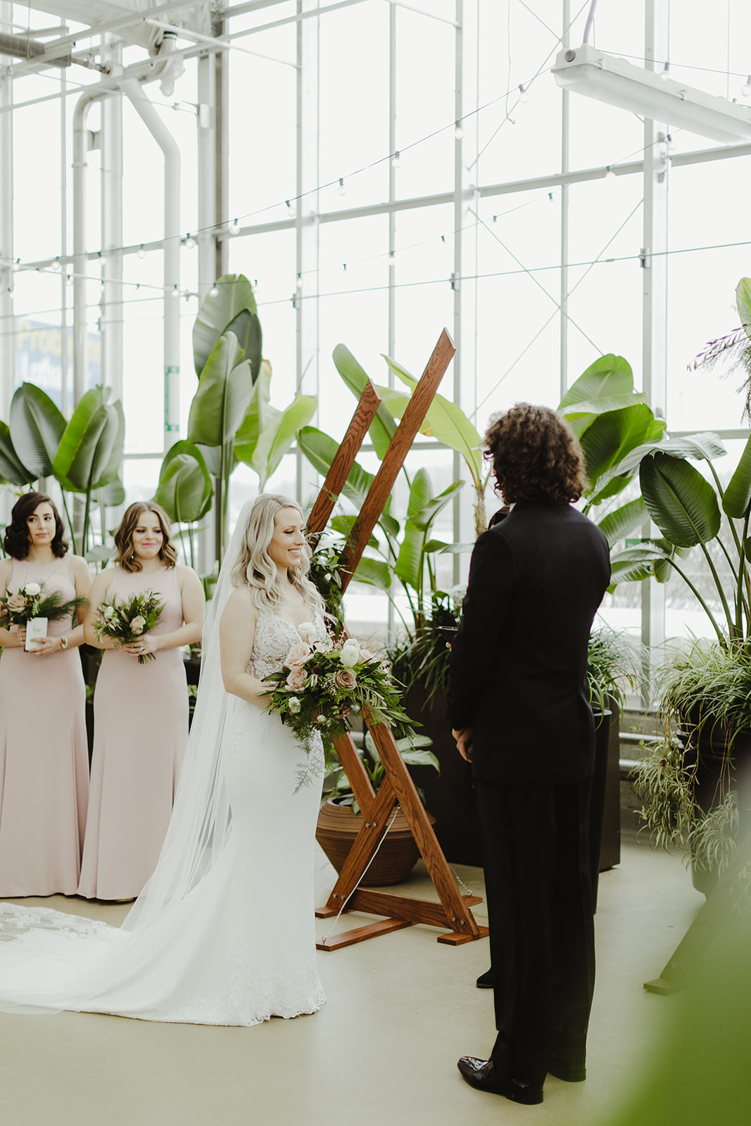 A couple smiling during their Downtown Market Grand Rapids wedding