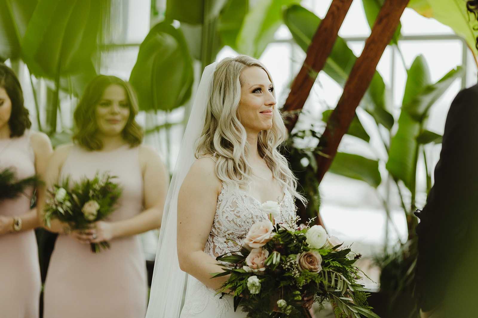 A bride smiling during her wedding ceremony in Grand Rapids, Michigan