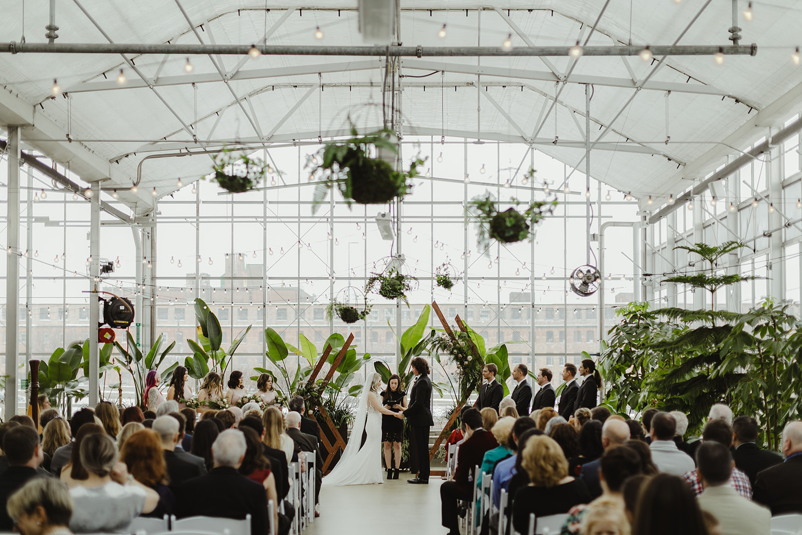 Guests enjoying a ceremony during a Downtown Market Grand Rapids wedding