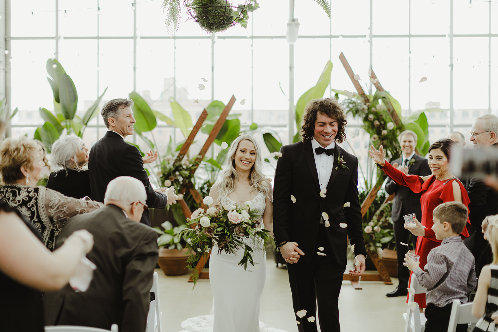 A couple walking down the aisle during their Downtown Market Grand Rapids wedding