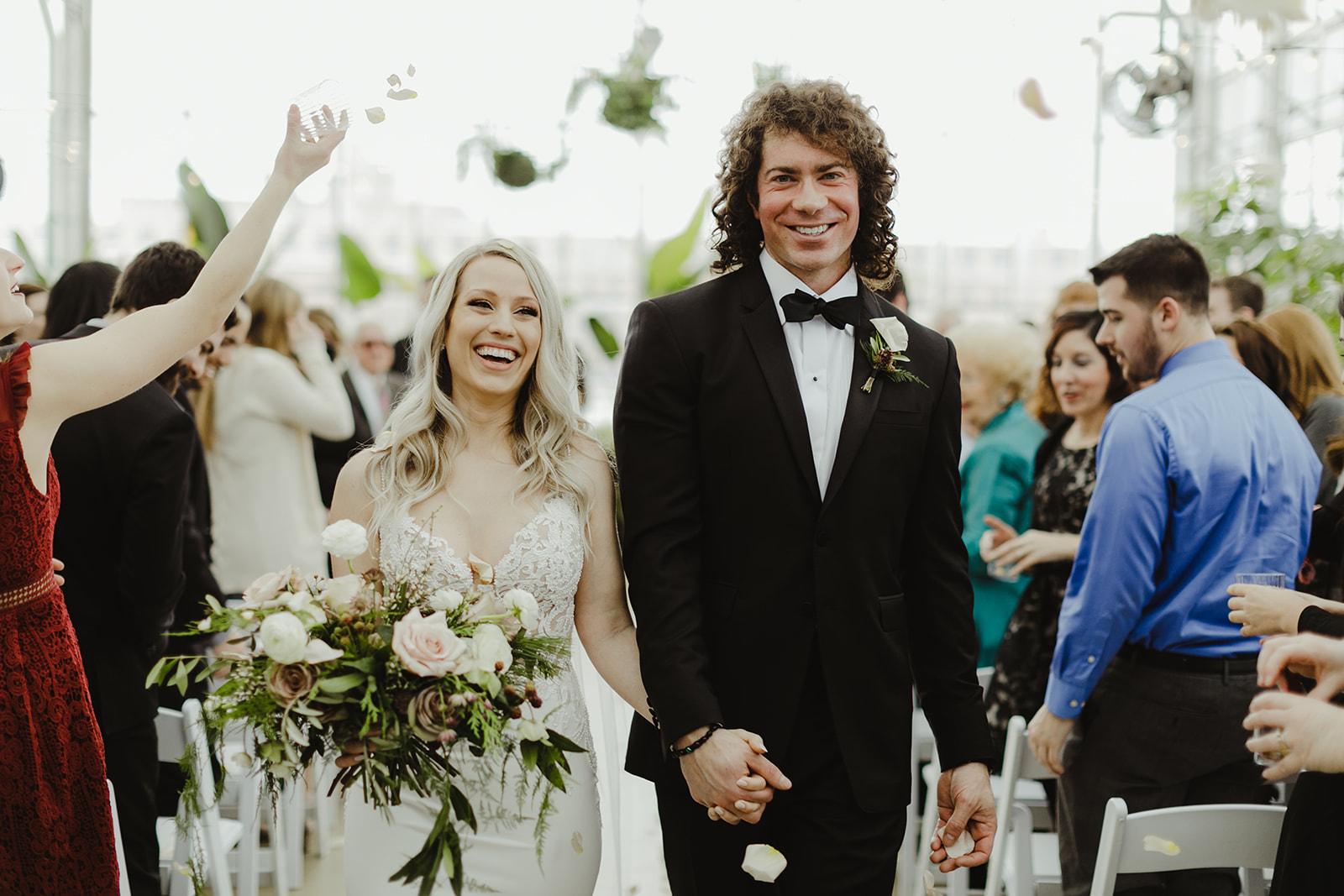 A couple smiling after their wedding ceremony
