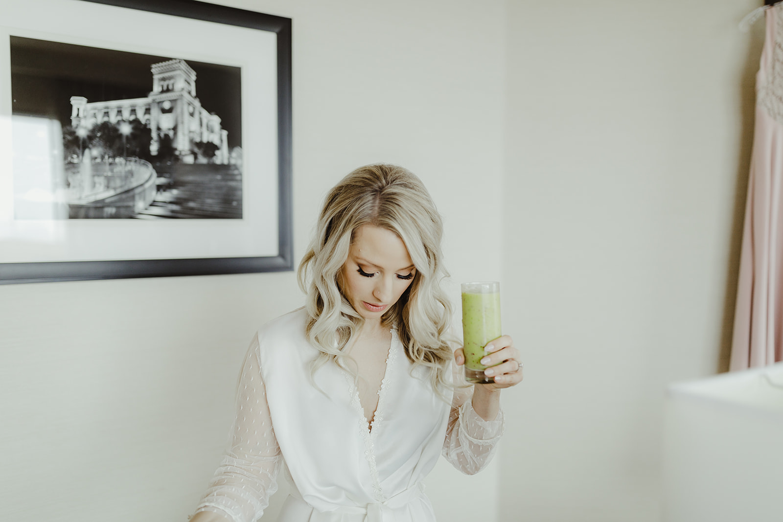A bride getting ready for her wedding day with a green juice