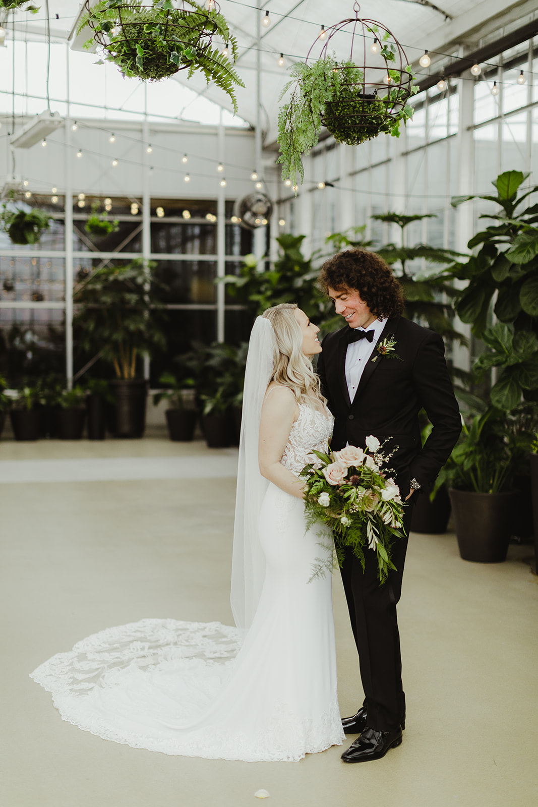 A couple smiling after their Downtown Market Grand Rapids wedding