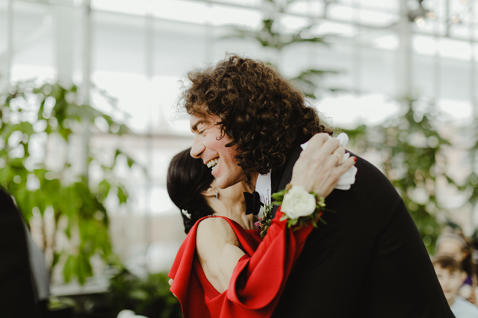 A groom hugging his mom on his wedding day