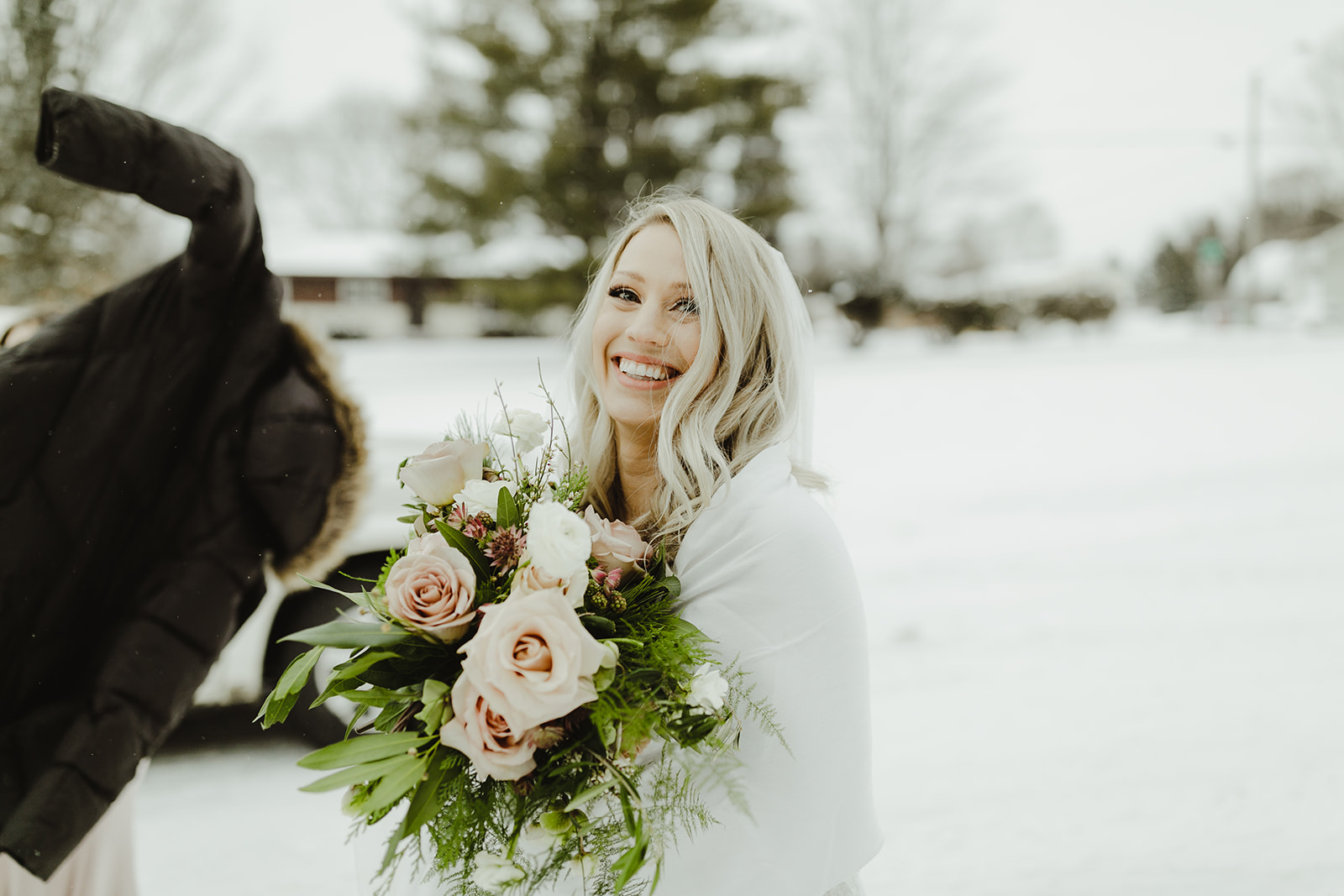 A bride smiling after her Grand Rapids, Michigan wedding