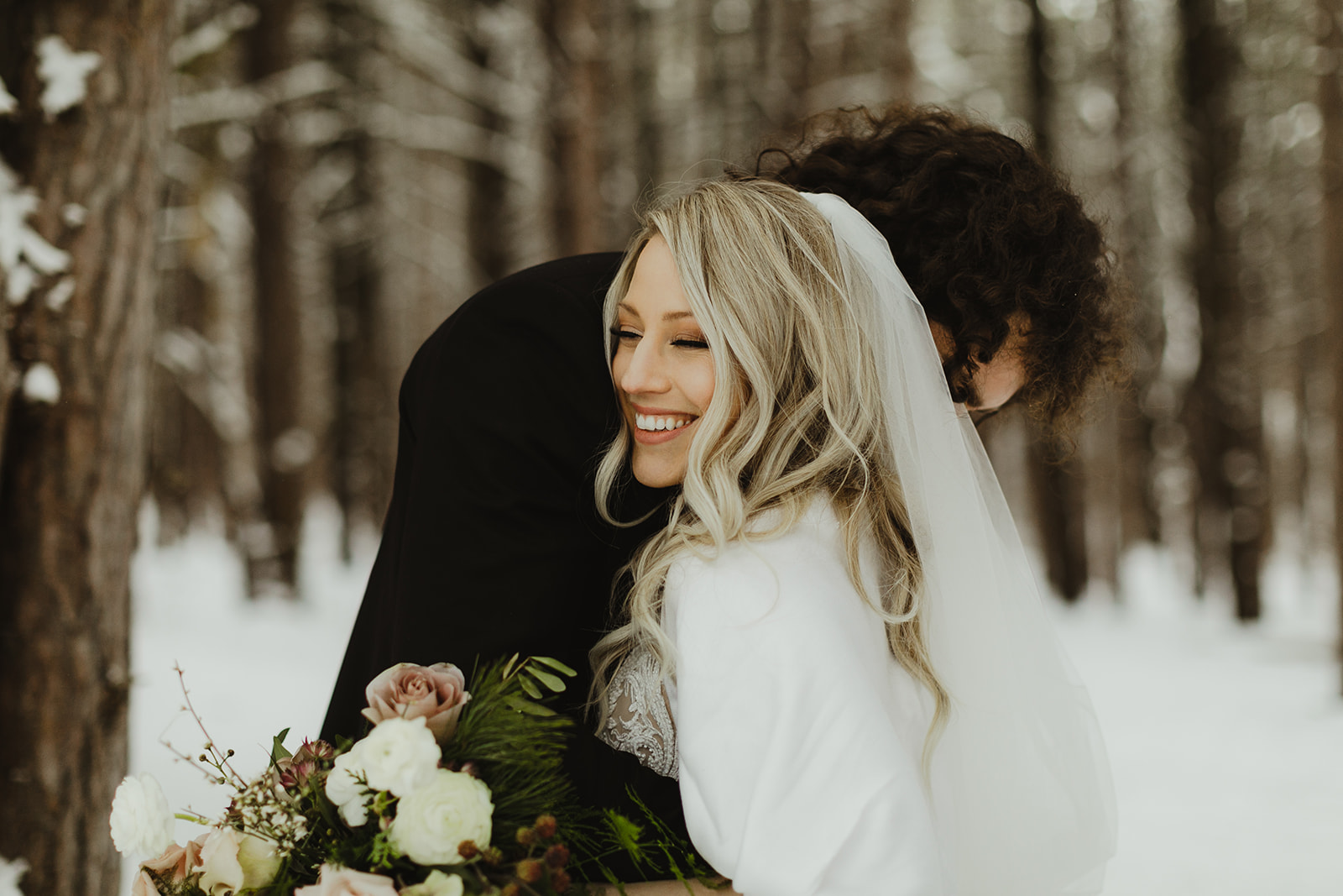 A bride and groom hugging after their Grand Rapids, Michigan wedding