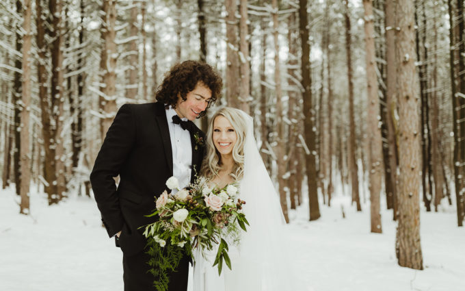Couple in the snow for their winter wedding in Michigan