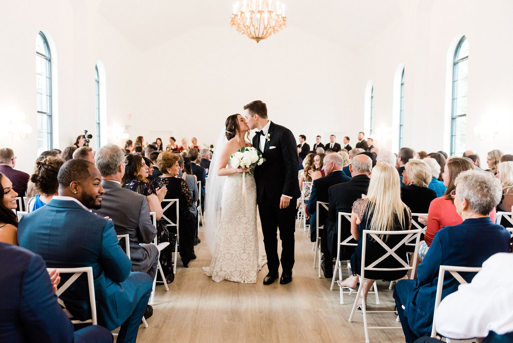 Couple kissing after their wedding at the Loft 310 Chapel