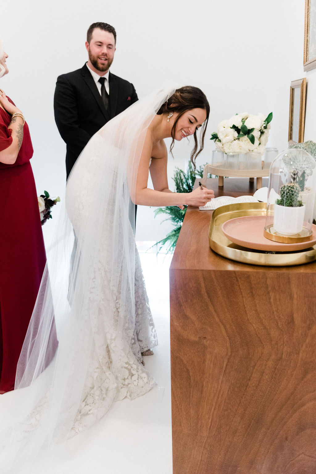 A bride signing her marriage license after her Kalamazoo, Michigan wedding