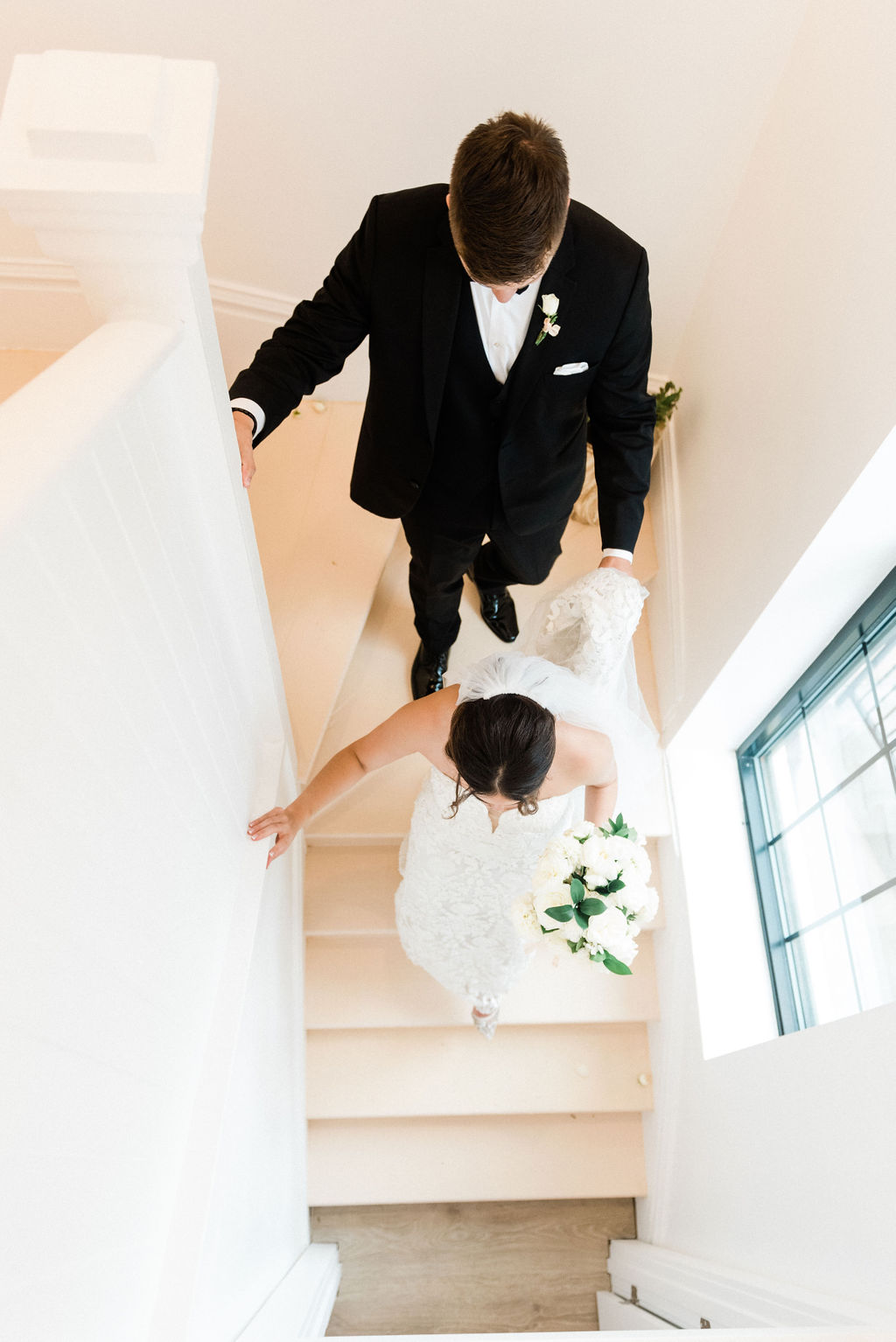 Couple walking down the stairs after their wedding at the Loft 310 Chapel