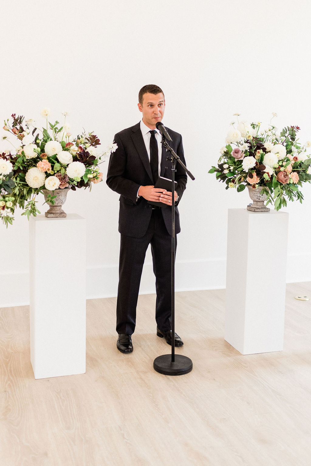 Officiant preforming a ceremony during a Kalamazoo, Michigan wedding