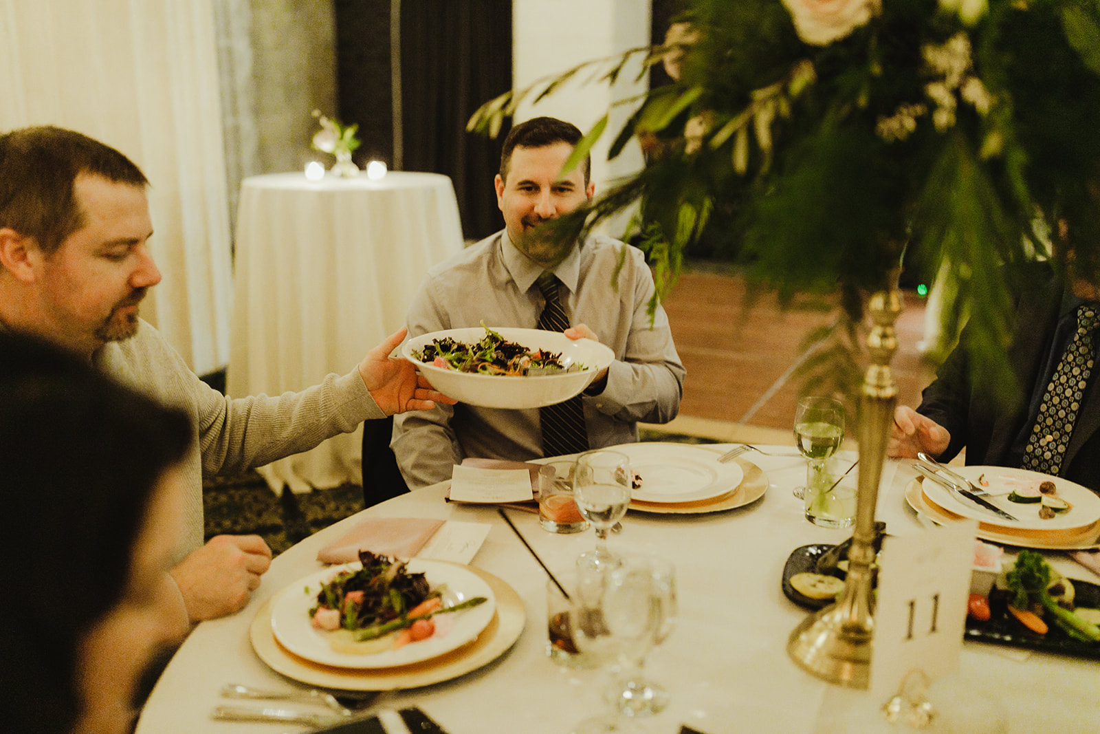 Guests passing around a plate of food during a Grand Rapids, Michigan wedding