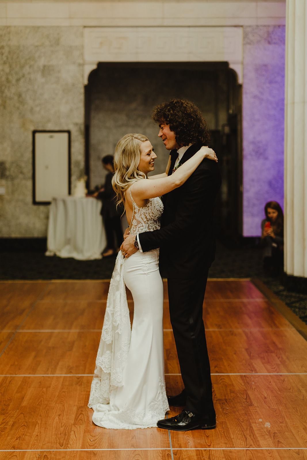 A couple smiling and dancing on their wedding day