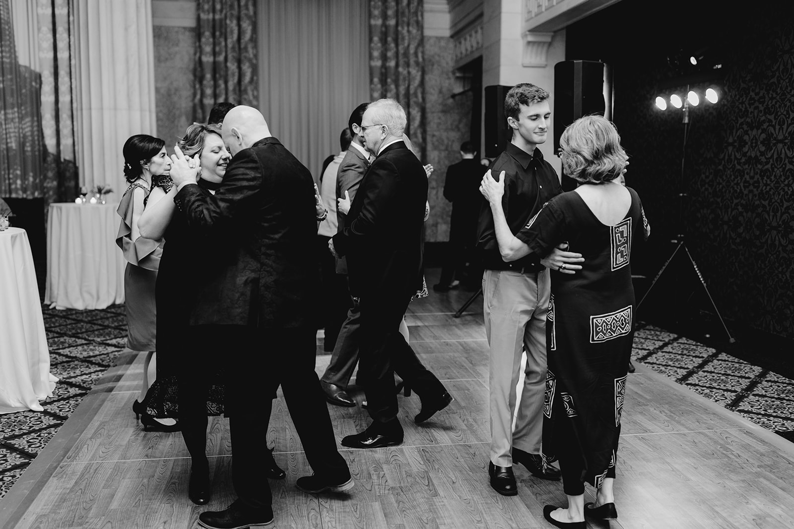 Guests dancing on the dance floor at a wedding reception