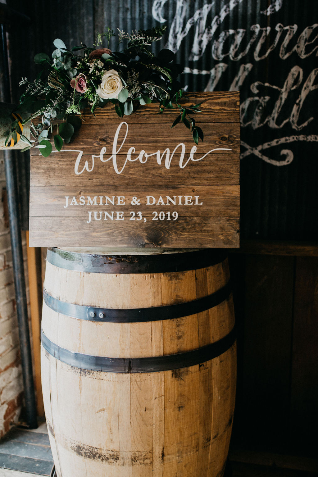 A wooden welcome sign