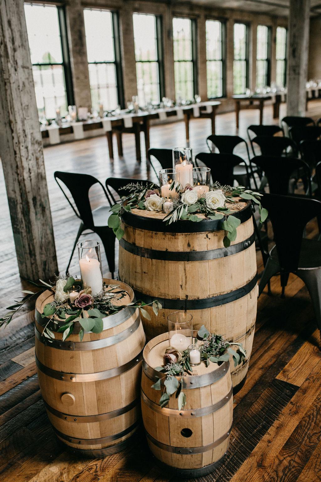 Whiskey barrels set with flowers and candles