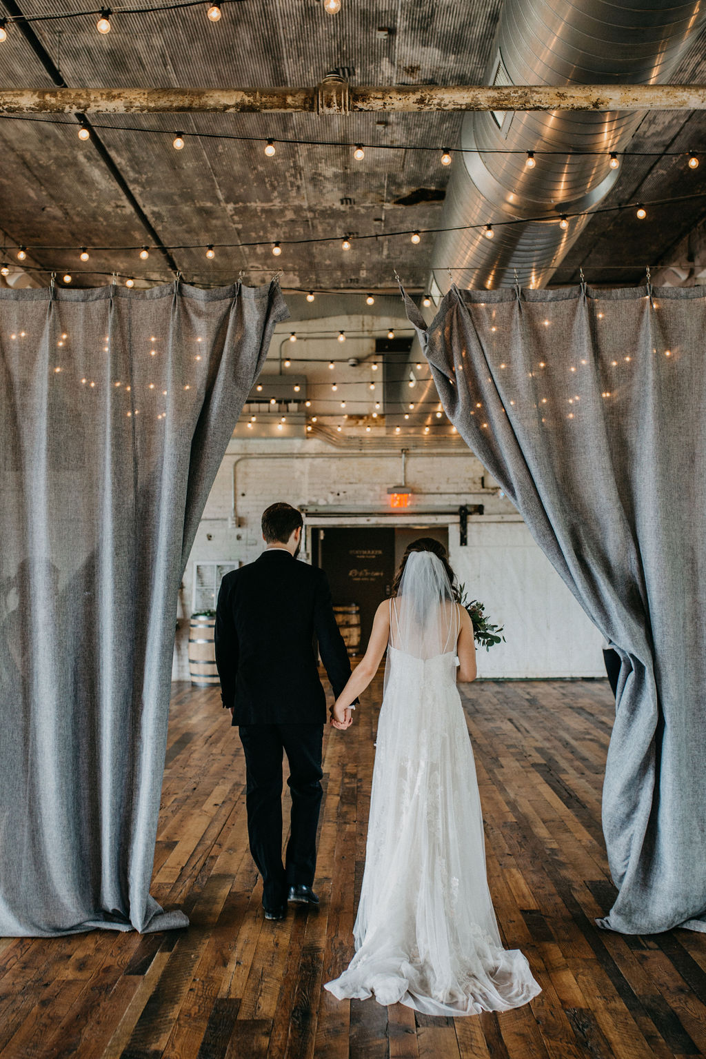 A couple recessing from their wedding ceremony