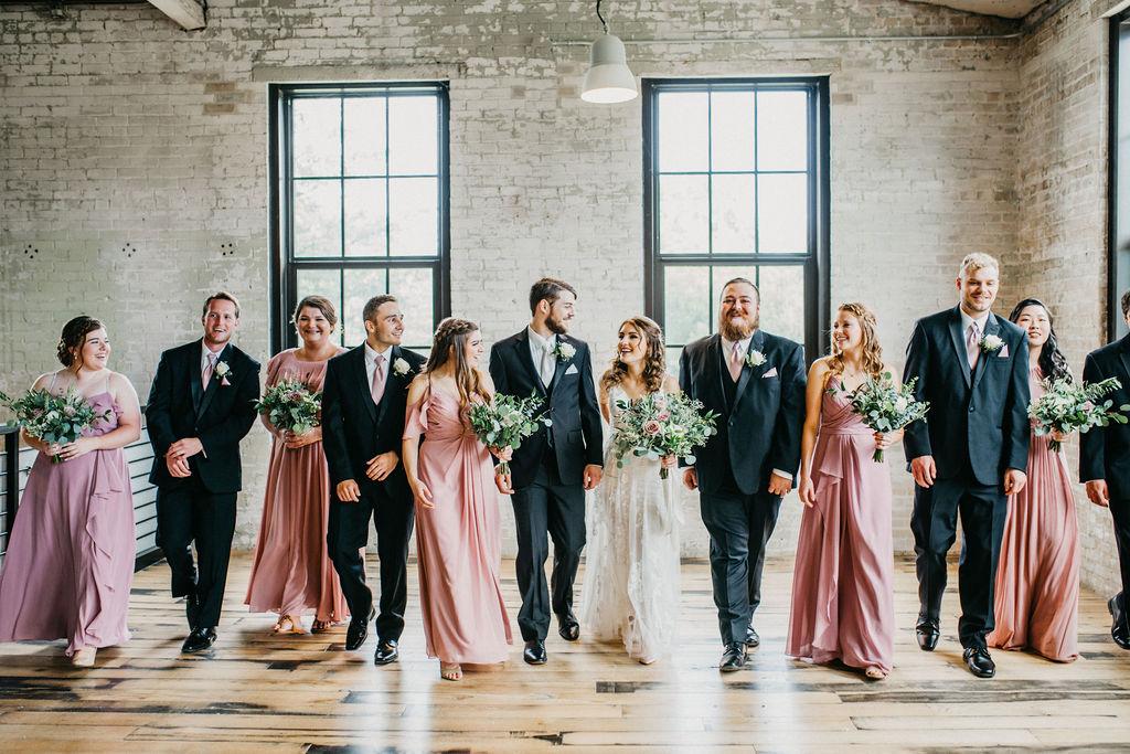 Bridesmaids and groomsmen smiling