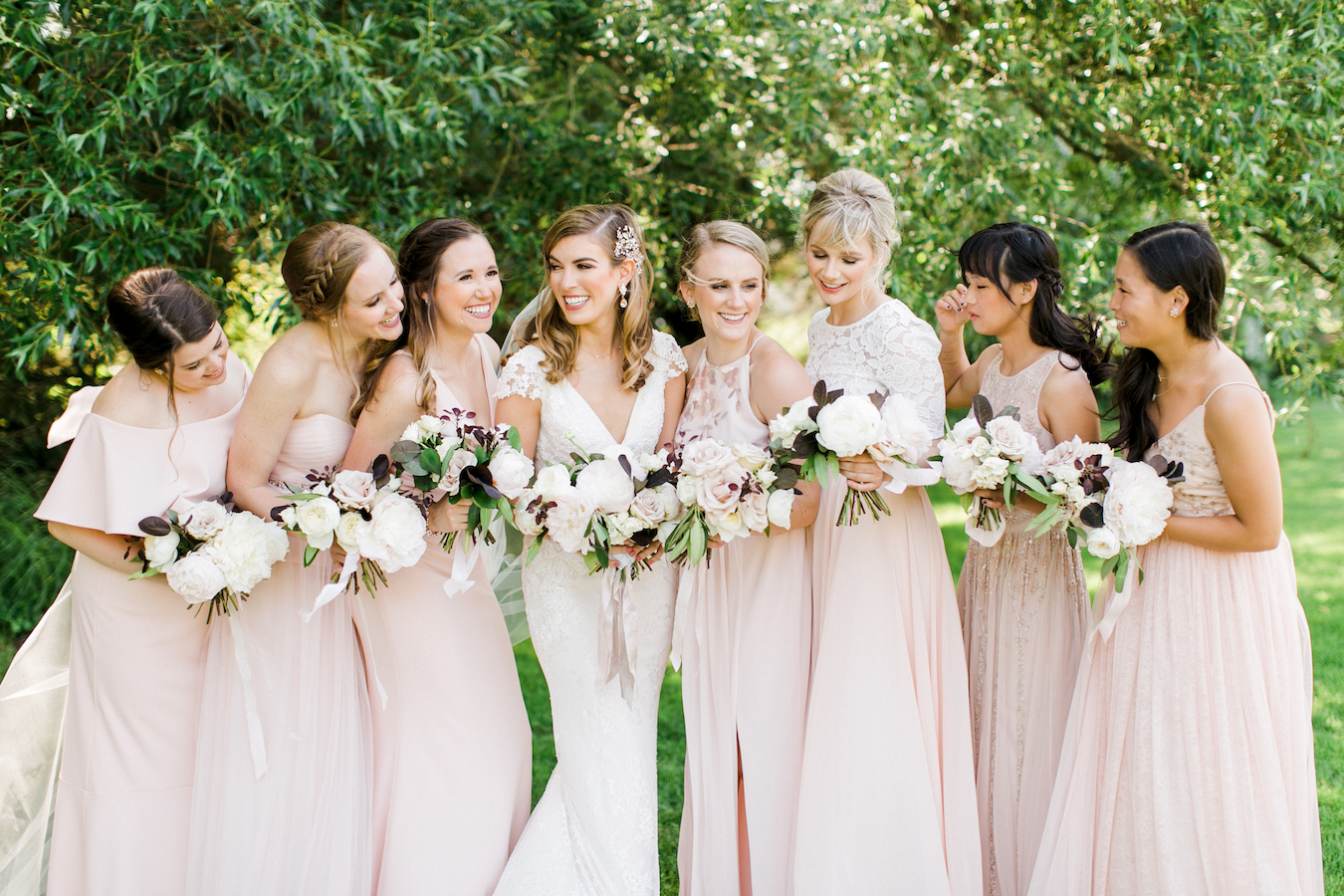 A bride and her bridesmaids smiling
