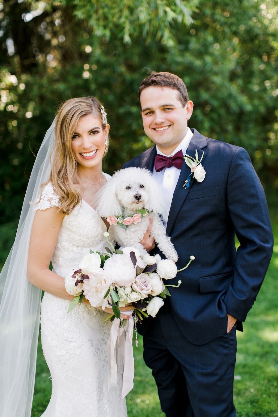 A bride, groom and their dog