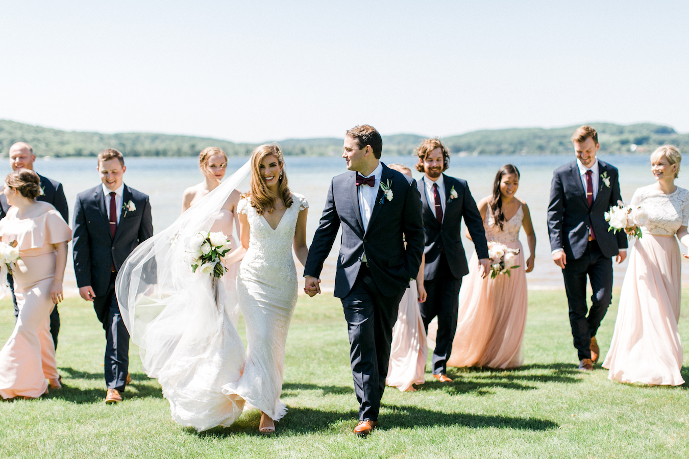 A wedding party smiling at Deer Lake, Michigan