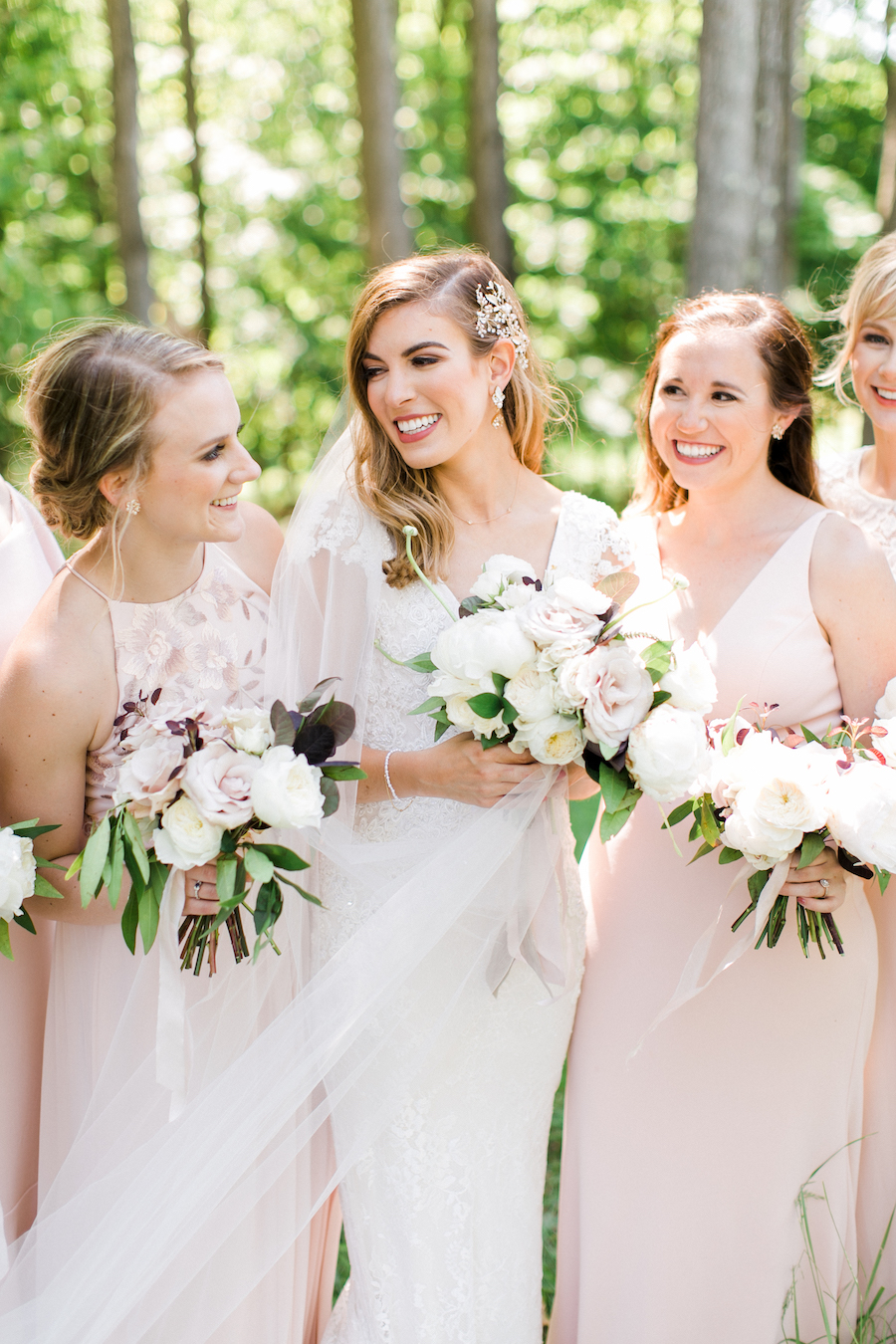 Bride and bridesmaids and their bouquets