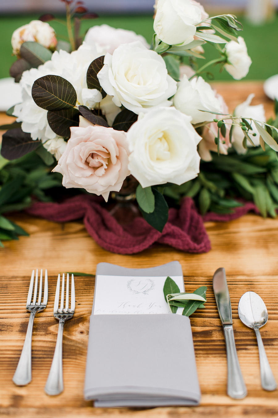 A blush and white table arrangement