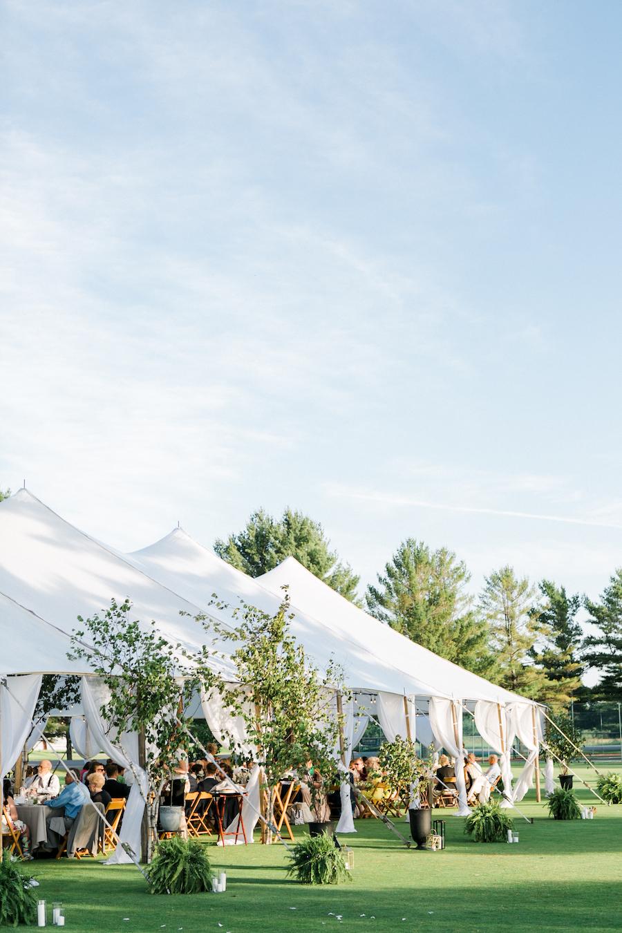 A garden themed outdoor tented wedding