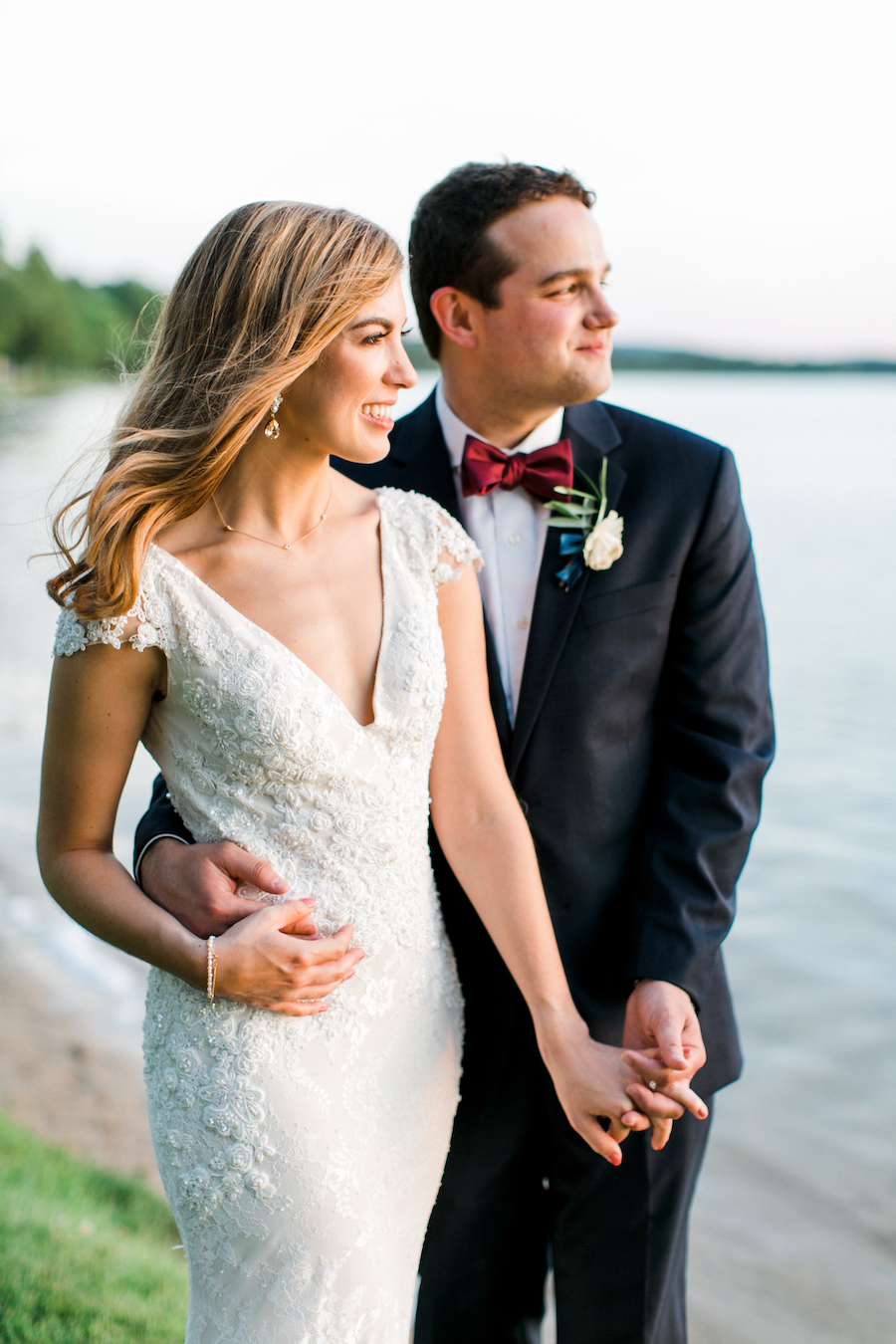 A couple smiling at the lake during their Deer Lake wedding