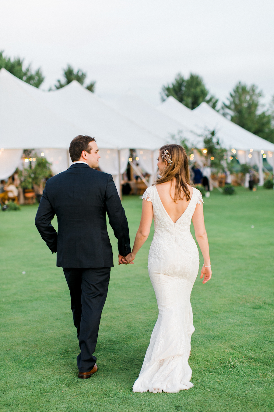 A couple walking back to their tent during their Boyne Mountain Resort wedding