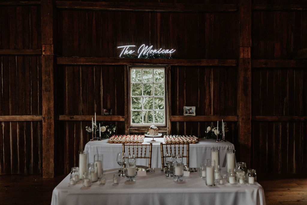 A sweetheart table set for a barn wedding
