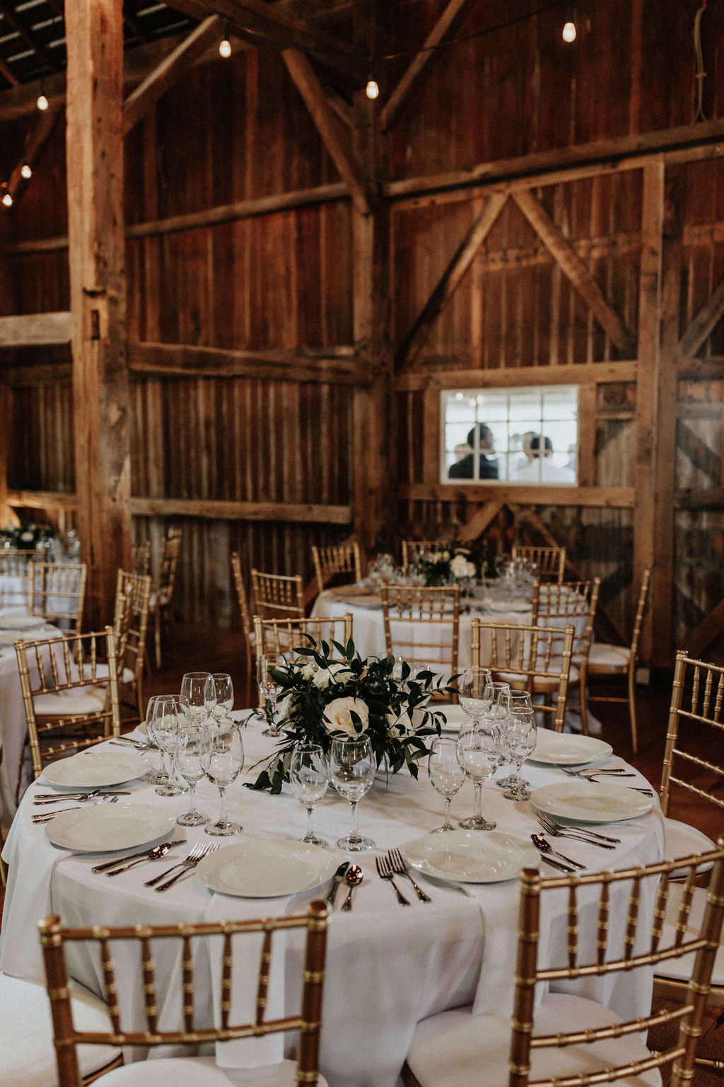 Tables set for a Hidden Vineyard Wedding Barn wedding reception.