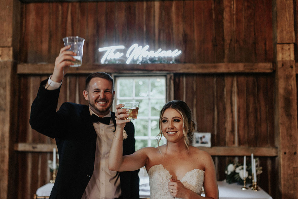 A couple toasting their guests