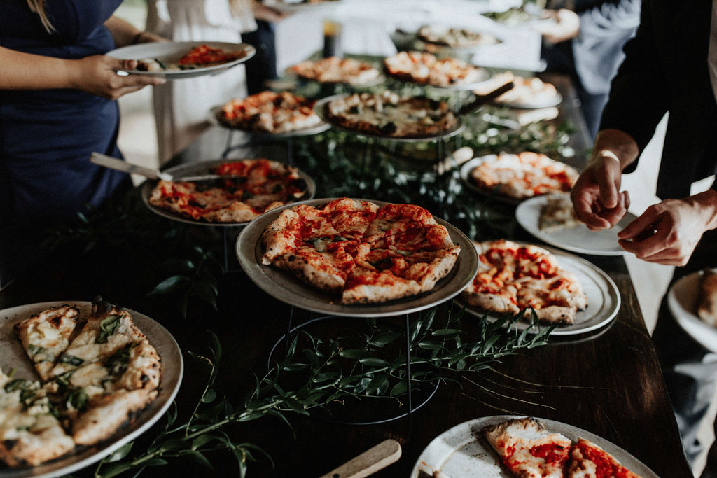 A pizza bar set at a wedding