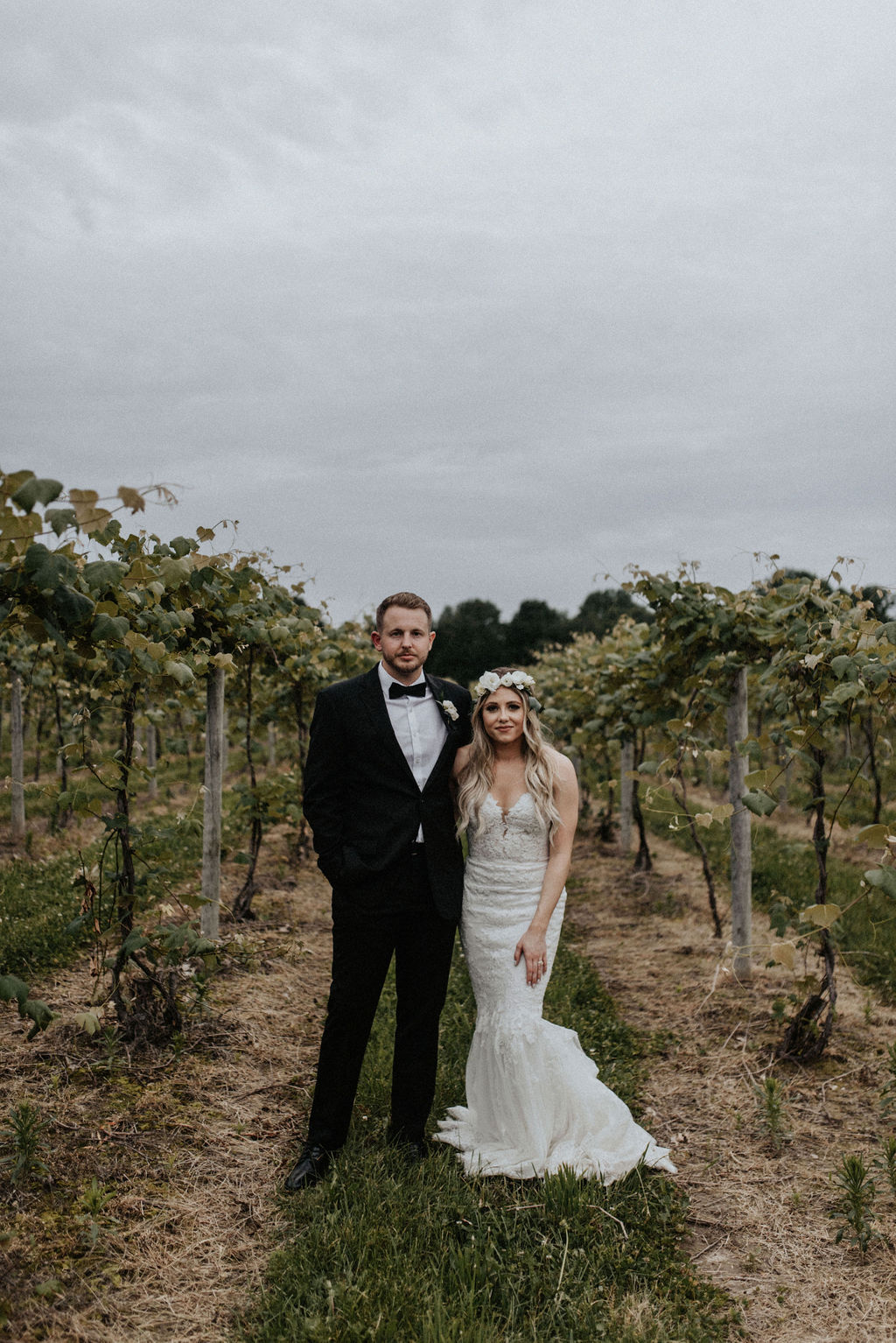 A couple smiling in the vineyards