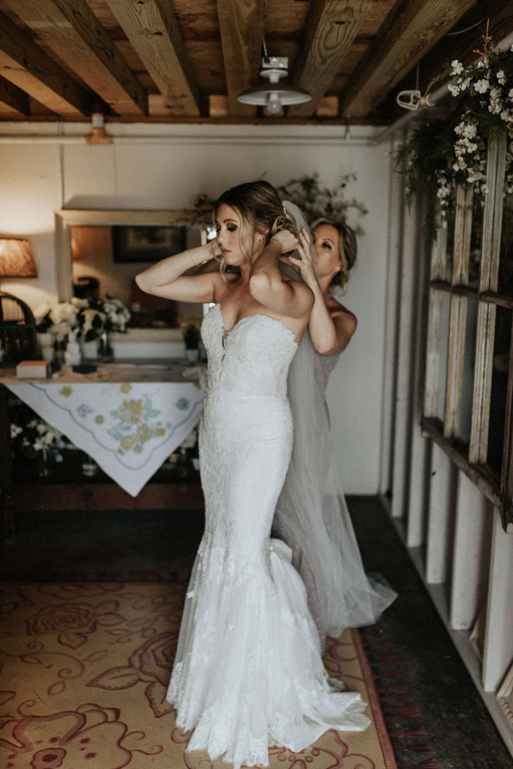 A bride and her mom getting ready for her wedding day
