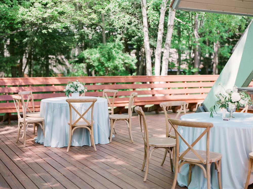 Light blue tables on a deck during a Leelanau school wedding