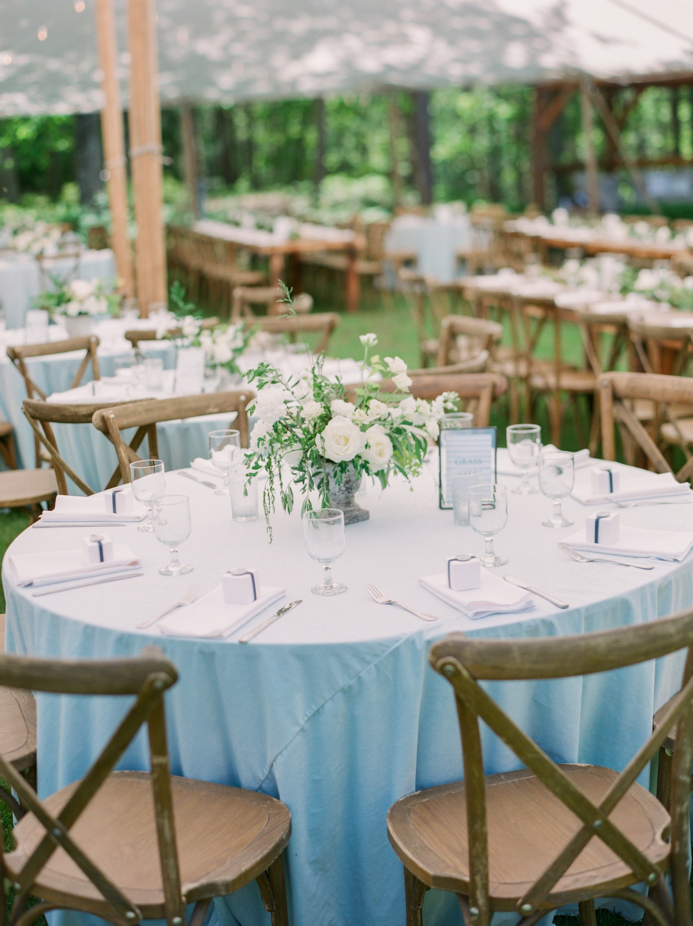 Tables set for a tented wedding in Glen Arbor, Michigan