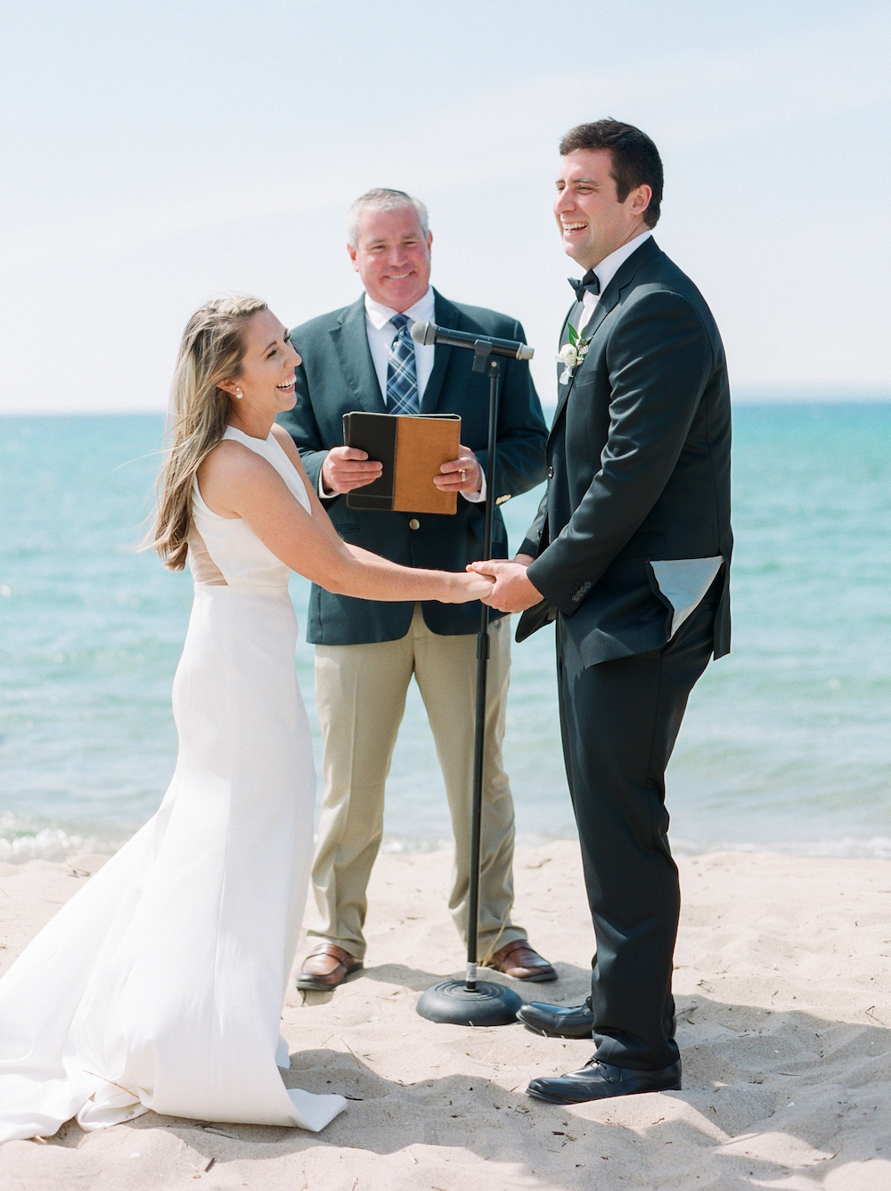 A couple smiling during their lake Michigan wedding