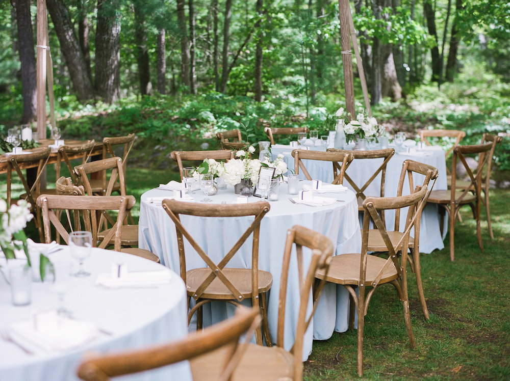 Tables set for a wedding in the woods