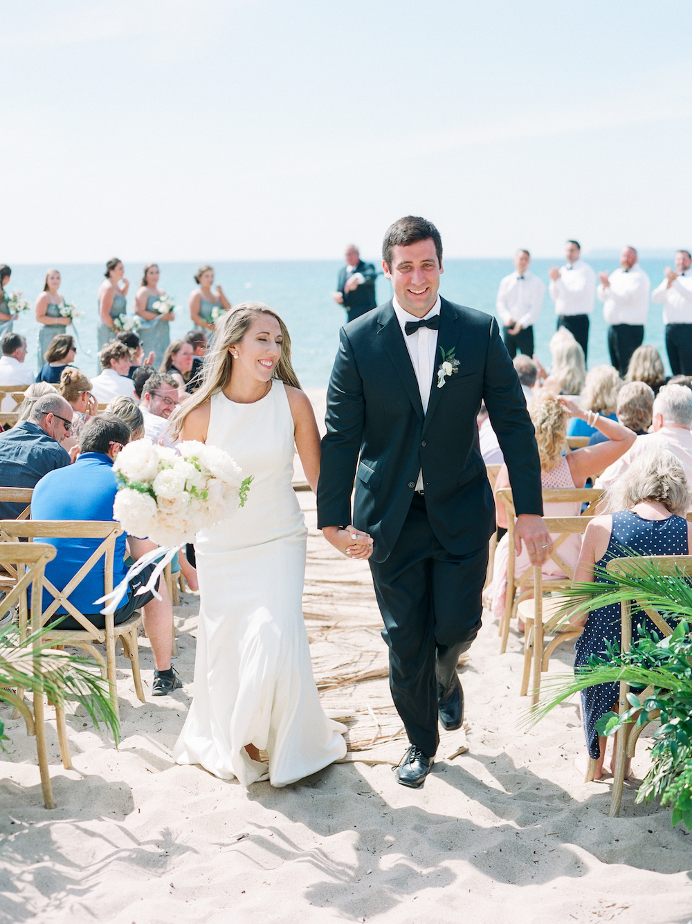 A couple smiling after their Glen Arbor, Michigan wedding