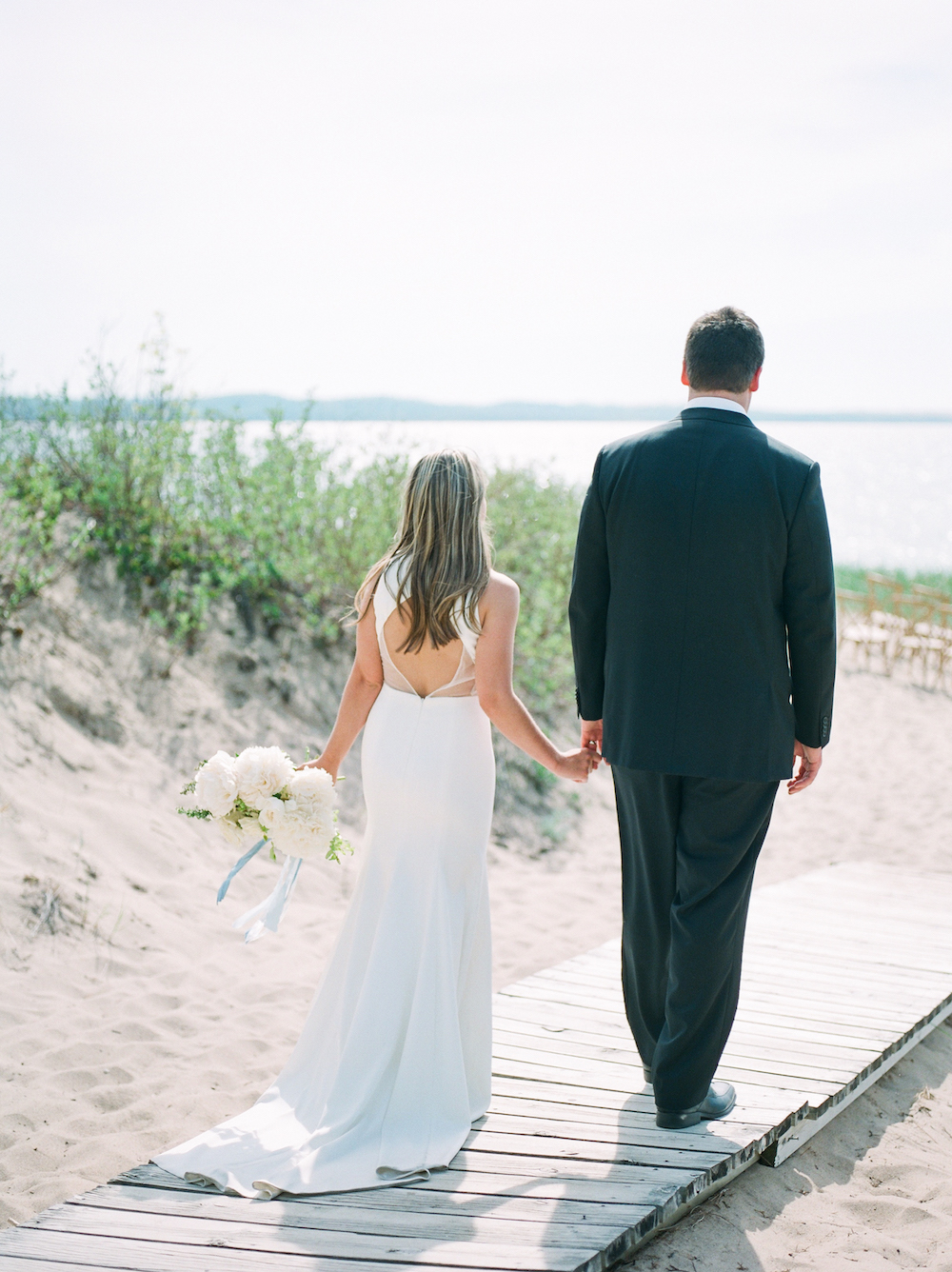 A couple during their Lake Michigan wedding