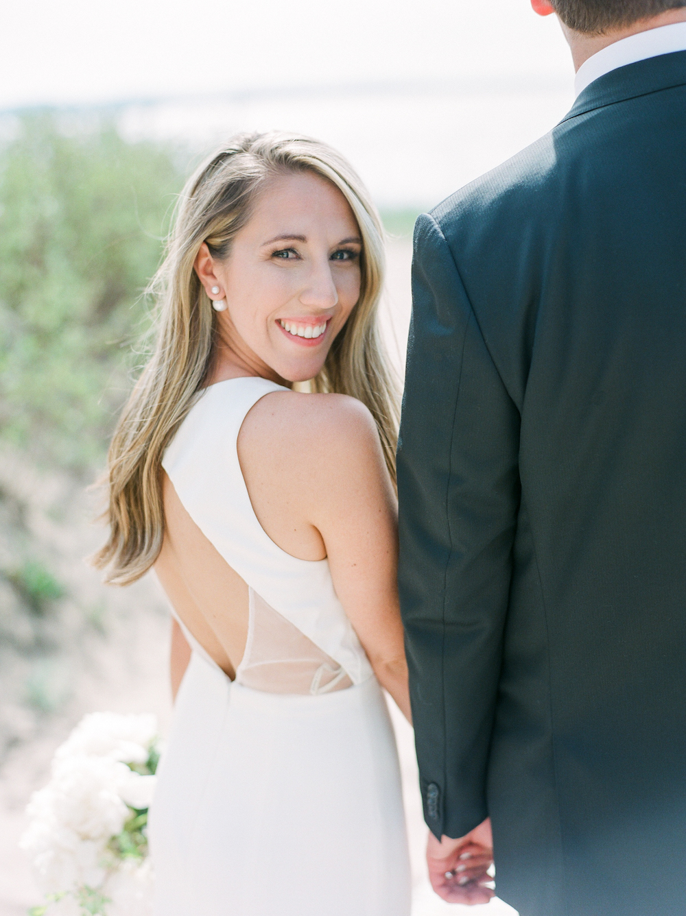 A bride smiling during her lake michigan wedding