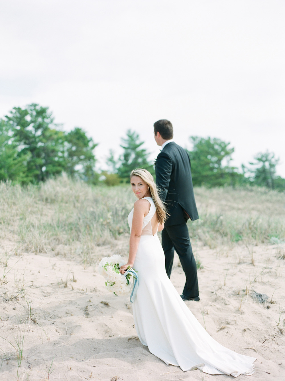 Couple on the beach during their Glen Arbor, Michigan wedding