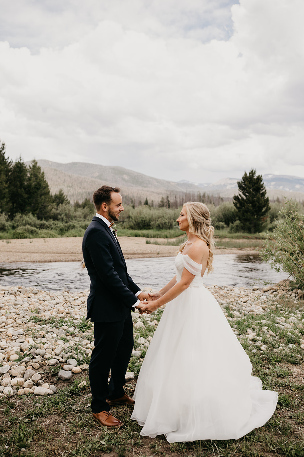 Couple smiling before their Colorado mountain wedding
