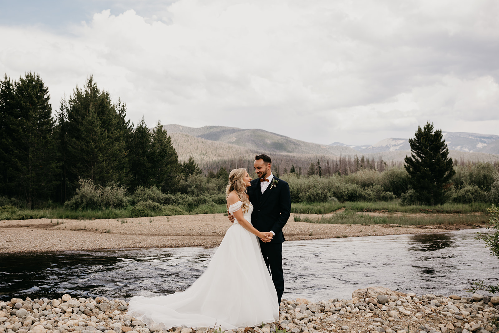 Couple smiling before their Rocky Mountain wedding