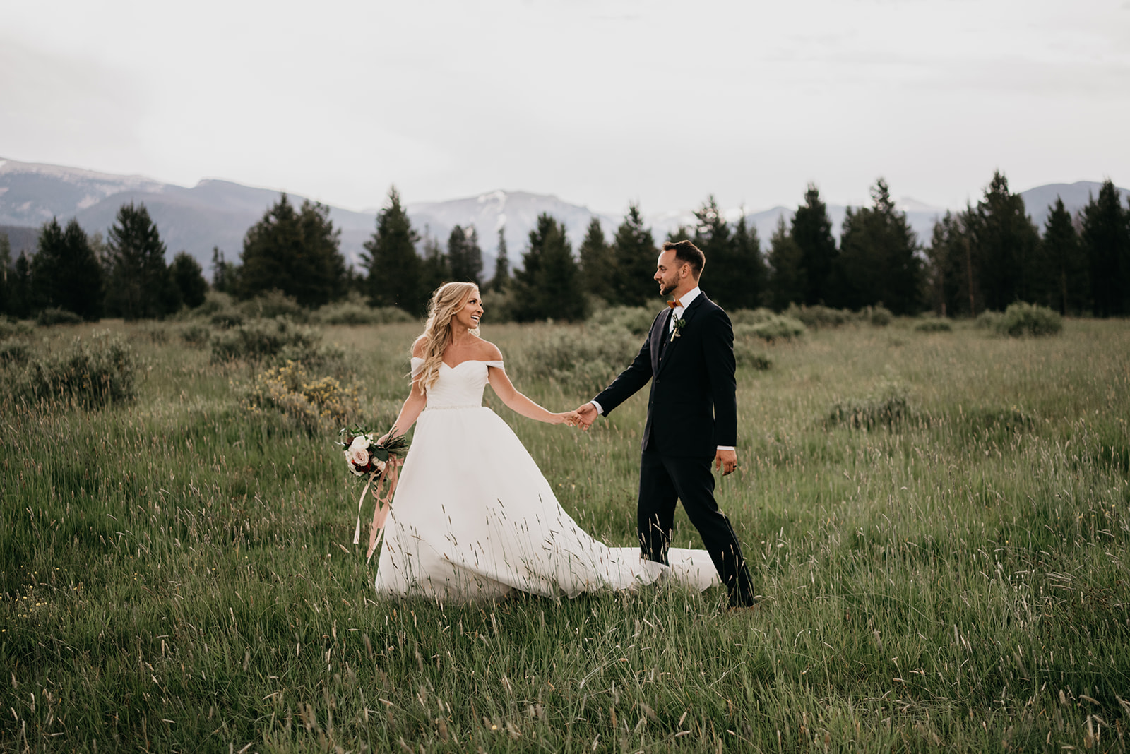 A couple smiling after their mountain wedding