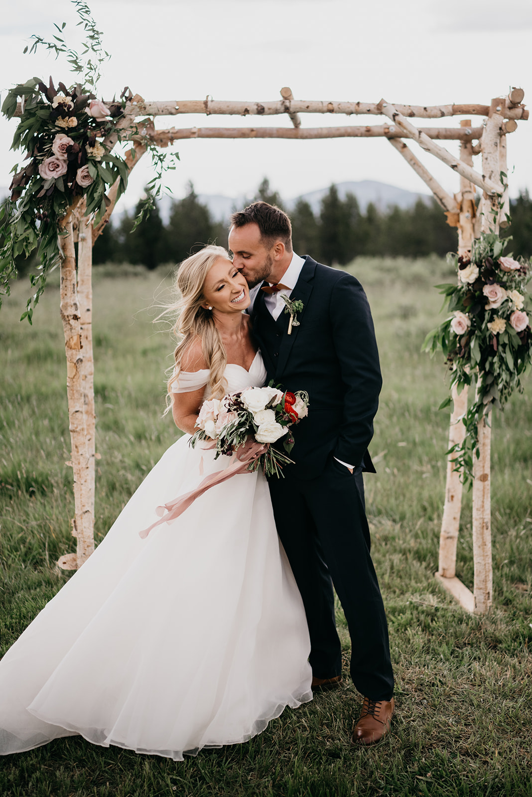 A couple smiling after their Colorado wedding